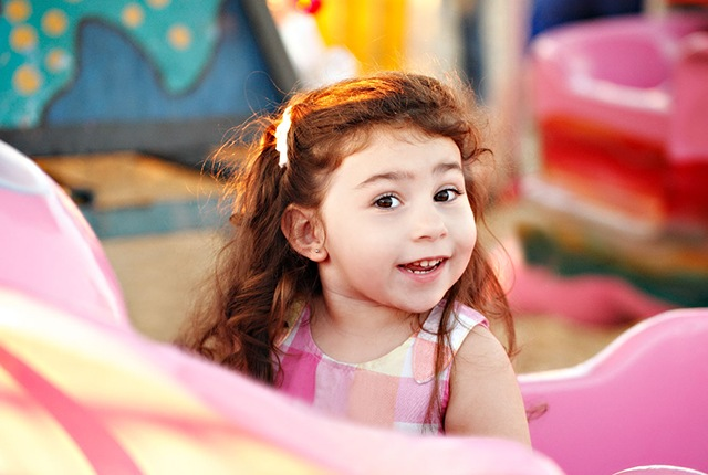 Young girl in colorful playroom