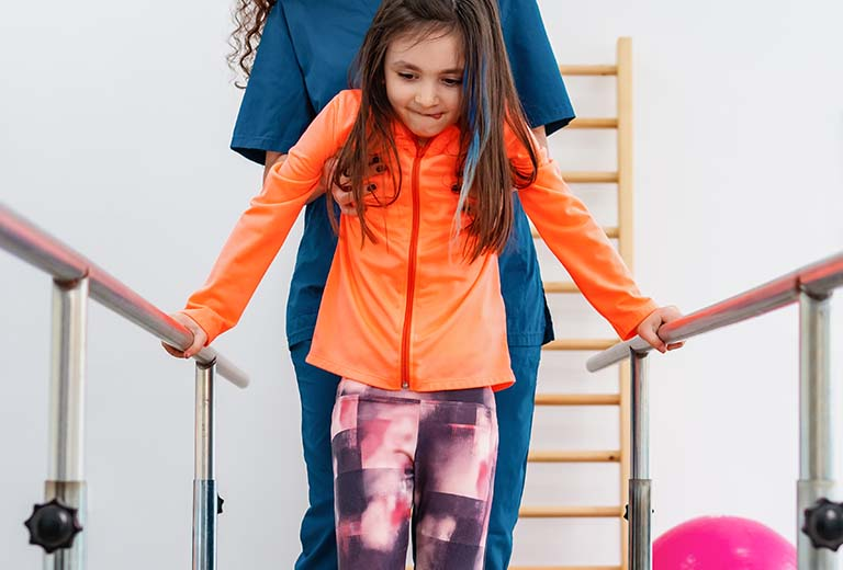 Girl going through rehab - Physical Medicine & Rehab