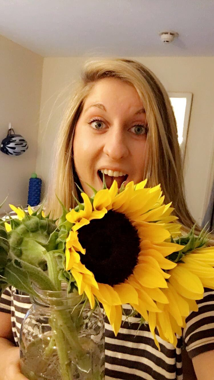 Katie Karp with flowers