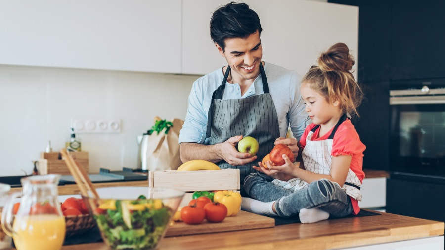 Dad cooks healthy meal with daughter
