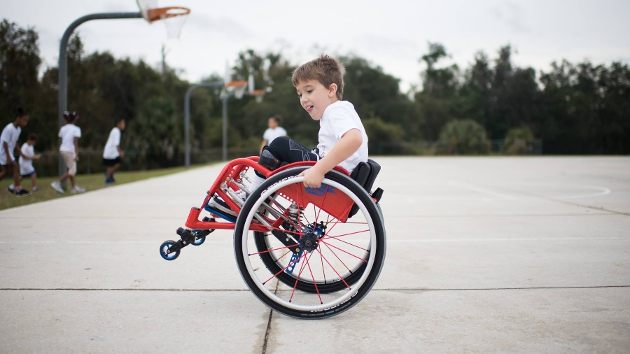 Child in wheelchair on basketball court