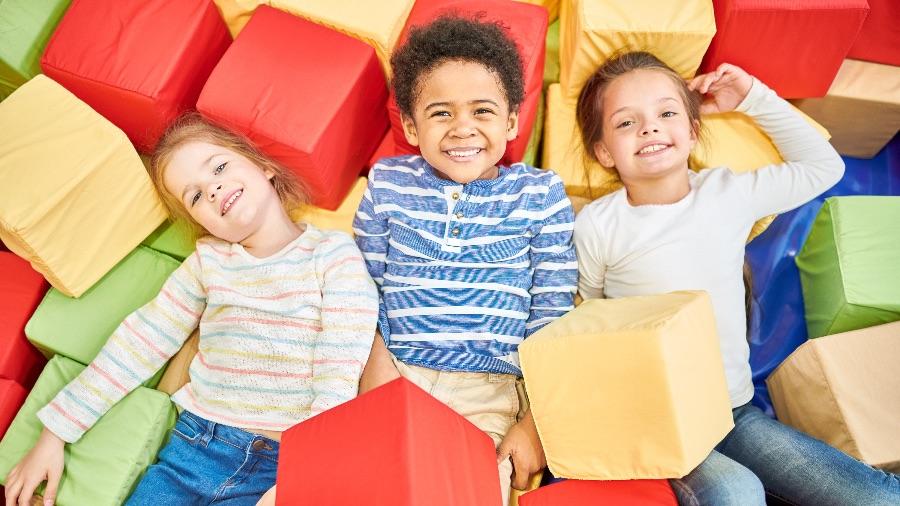 Kids smiling in foam pit