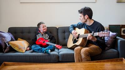 Male music therapist and patient playing guitar