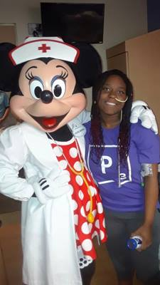 Woman smiles with Minnie Mouse