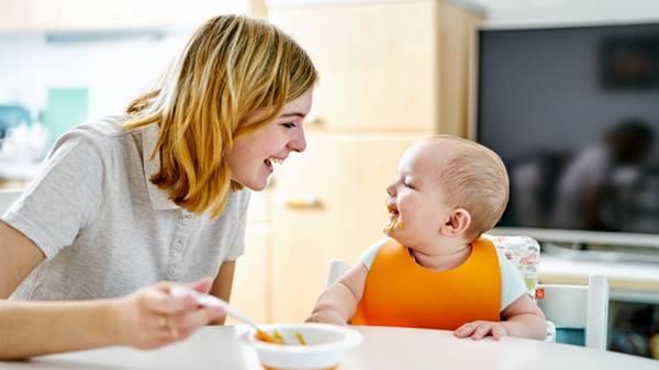 Mom feeding infant solid food