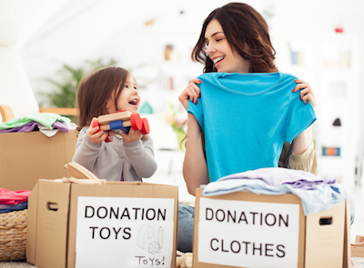 Mom and Daughter Donating Toys and Clothes
