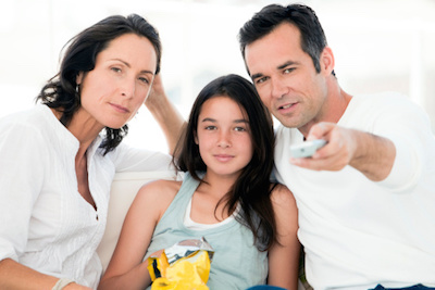 Parents Watching TV with Teenage Daughter