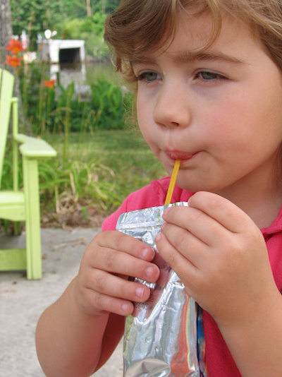 Girl Drinking Juice Box