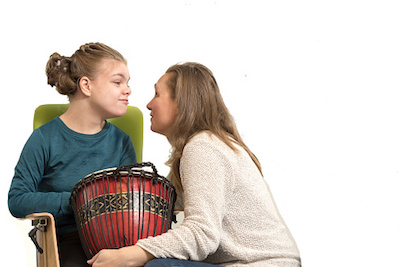 Girl with Drum in Music Therapy
