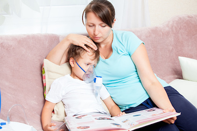 Mom Reading to Son During Asthma Treatment