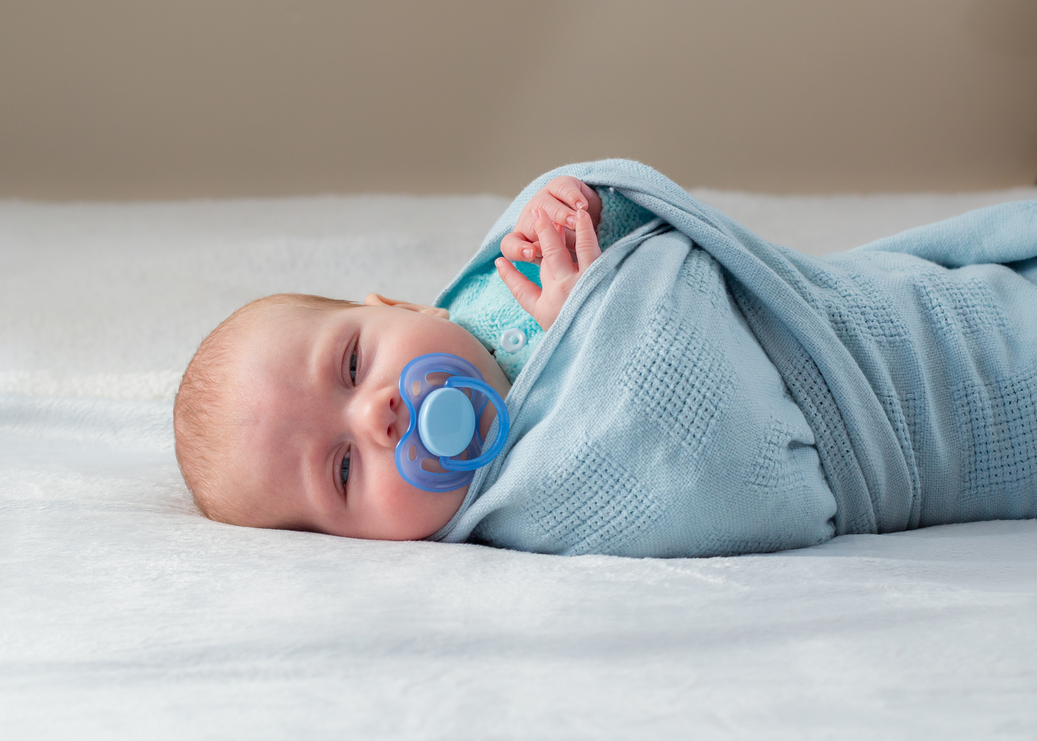 Tight swaddling damages baby's joints