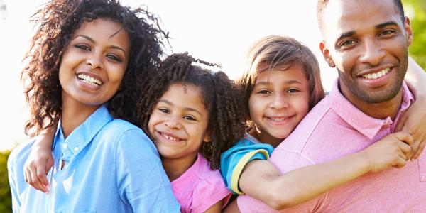 African American Parents Giving Children Piggyback Rides 460518719_3867x2578