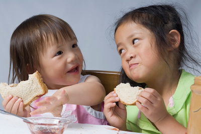 Girls eating PB&J