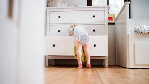 Child digging through dresser